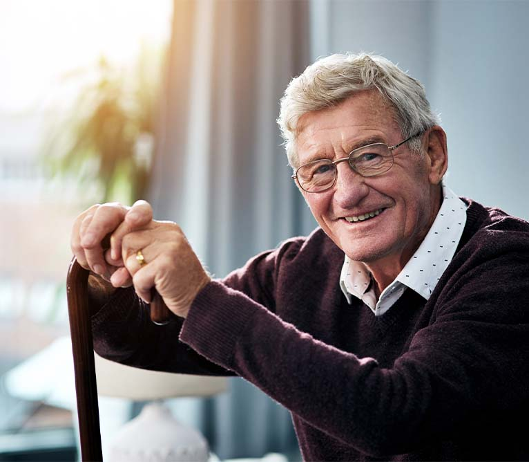man with cane smiling